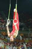 俄罗斯联邦的丹尼斯Abliazin竞争在人` s圆环最后在艺术性的体操竞争在里约2016奥运会 免版税图库摄影