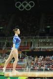 俄罗斯联邦的艺术性的体操运动员阿莉娅・穆斯塔芬娜在平衡木竞争在妇女` s全能体操在里约2016年 免版税库存照片