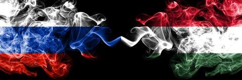 俄语对匈牙利,肩并肩被安置的匈牙利烟旗子 俄罗斯和匈牙利,匈牙利语的厚实的色的柔滑的烟旗子 皇族释放例证