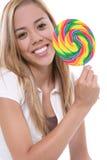 俏丽女孩的棒棒糖 图库摄影