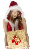 俏丽的女孩Xmas射击有礼物的 库存照片