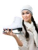 俏丽的妇女形象溜冰者显示一只冰鞋 免版税库存图片