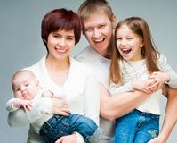 俏丽的微笑的家庭 图库摄影