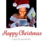 俏丽的浅黑肤色的男人的综合图象圣诞老人成套装备开头礼物的 免版税图库摄影