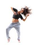 俏丽的节律唱诵的音乐样式十几岁的女孩跳跃的跳舞 图库摄影