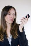 俏丽移动电话的女孩 免版税库存照片