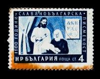 保加利亚邮票显示作家,斯拉夫语保加利亚字母表1100周年,大约1955年 免版税图库摄影