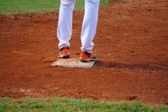 保卫基地的棒球运动员 库存照片