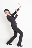 保卫某事的亚裔女实业家 免版税库存图片