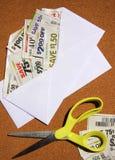 保存在信包的赠券 免版税库存照片