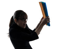 保护在文件夹文件剪影之后的女商人 免版税库存照片