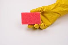 保护有橡胶手套的妇女手免受洗涤剂作为他们 免版税库存图片