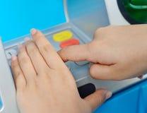 保护ATM针用人工 免版税库存图片