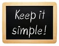 保持它简单-有文本的黑板在白色背景 免版税库存图片