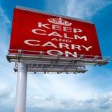 保持镇静并且继续广告牌 免版税库存照片