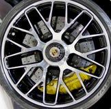 保时捷商标在轮子的 免版税库存照片