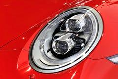 保时捷红色跑车系列911 carrera 4GTS车灯  免版税库存照片