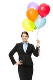 保留五颜六色的气球的女商人画象 图库摄影