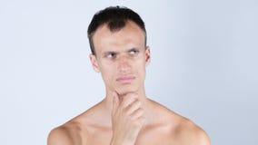 保留他的手的赤裸上身的人画象由面孔,当认为时 库存照片