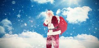 保留秘密的圣诞老人的综合图象 库存图片