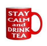 保留镇静在白色的饮料茶红色杯子 免版税库存图片