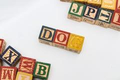 信件的安排形成一个词,版本66 库存图片