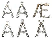 信件` A `变形,装配从金属零件 免版税图库摄影