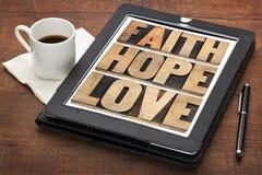 信念、希望和爱在数字式片剂 免版税图库摄影