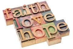 信念、爱和希望词摘要 免版税库存照片