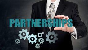 信托业务合作的概念 商人举行在手上真正词 免版税库存照片