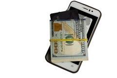 信用卡、美元和智能手机 库存照片