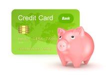 信用卡和桃红色存钱罐。 免版税库存图片