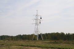 信赖与补偿器的输电线 库存图片