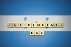 信件与文本在洪都拉斯的国旗的独立日 库存照片