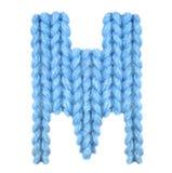 信件M英语字母表,上色蓝色 库存图片