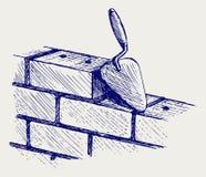 修平刀和砖 免版税图库摄影