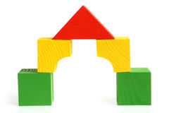 修建儿童房子的块使s木 库存照片