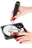 修理妇女的计算机hdd 免版税库存照片
