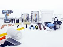 修理辅助部件 套工具和油漆进行的修理 库存照片