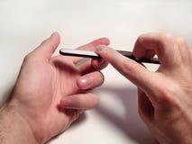 修饰在一个人的手上的钉子 库存图片