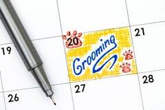修饰在与笔的日历的提示 图库摄影