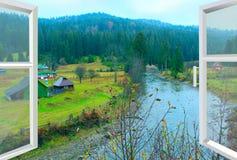 俯视河和山的被打开的窗口 库存照片