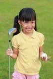 俱乐部女孩高尔夫球一点 库存图片