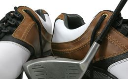 俱乐部高尔夫球鞋子 免版税库存照片