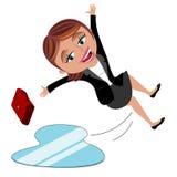 滑倒冰的女实业家 库存图片