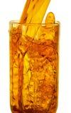 倒在玻璃的汁液 免版税图库摄影