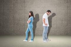 翻倒夫妇的综合图象不互相谈话在战斗以后 图库摄影