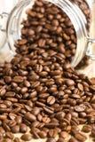 倒的豆咖啡 免版税库存图片