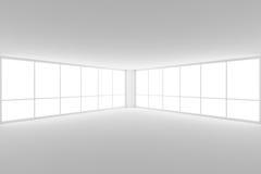倒空与两个大窗口的白色营业所室角落 免版税图库摄影