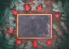 倒空在棕色木背景的黑框架 库存图片